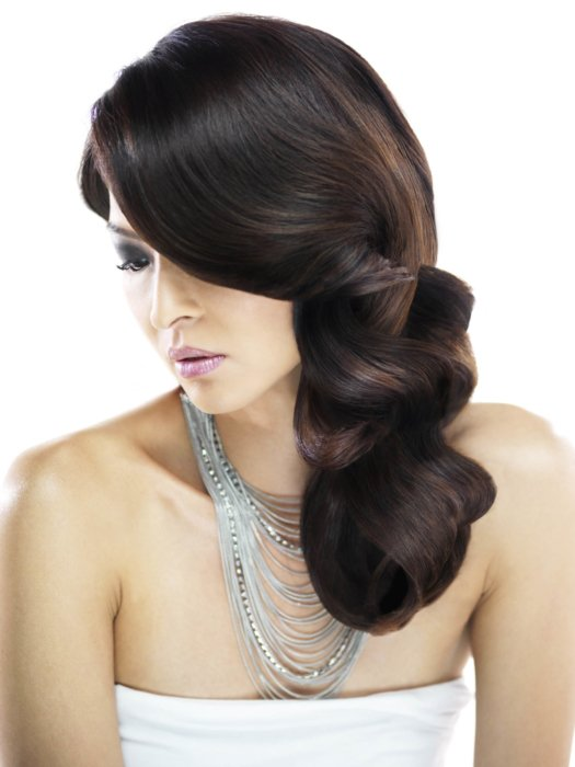 Beauty shot of a woman's thick and flowing dark hair