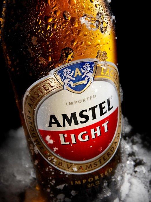 Amstel Light brown beer bottle in ice