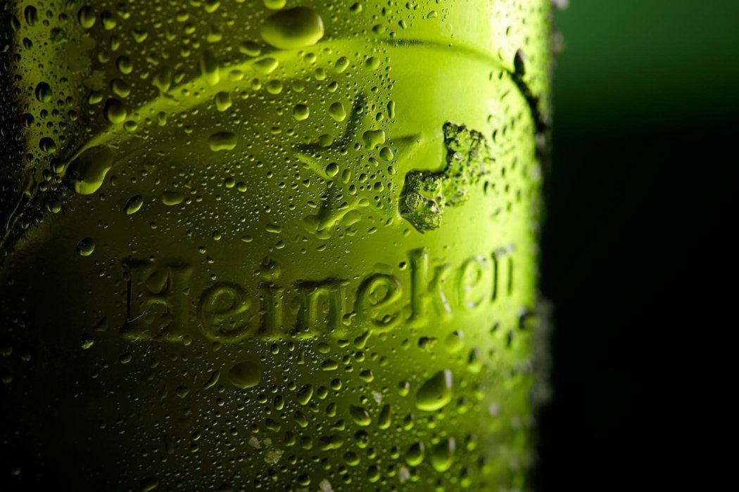 Close up Heineken beer bottle on a green background