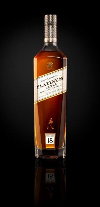 Johnnie Walker platinum label on black background. A liquor bottle image
