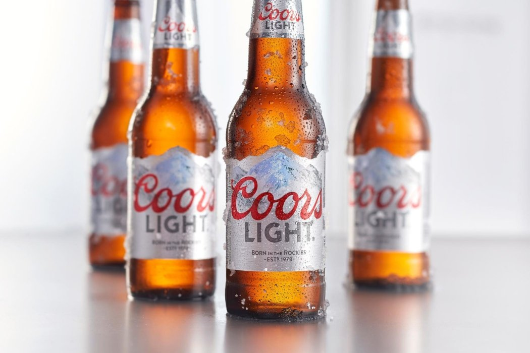 Coors light beer bottles arranged with a light background