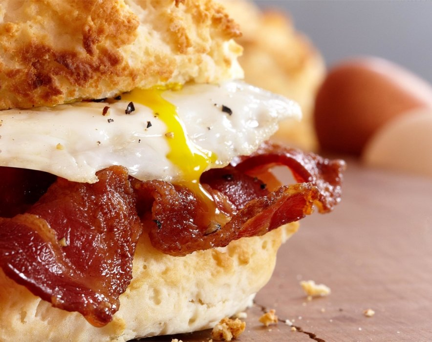 Breakfast sandwich with eggs and bacon