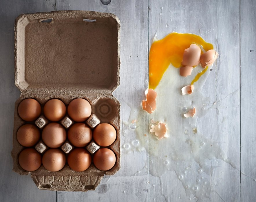 Raw fresh eggs with one smashed