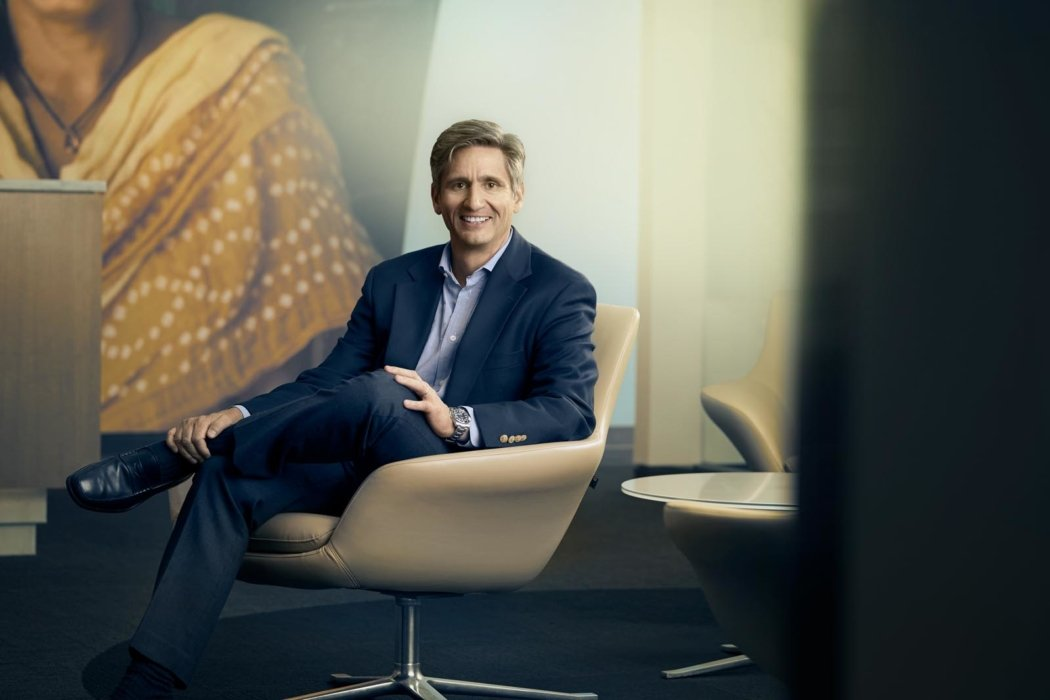 Portrait of man in chair after retouching