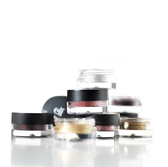 Small cometics makeup with lid arranged on a white background