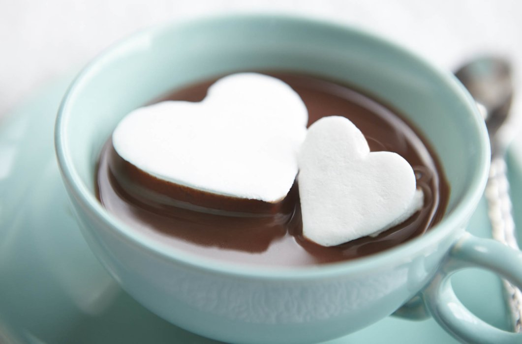 Heart shaped marshmallows in a chocolate filled tea cup