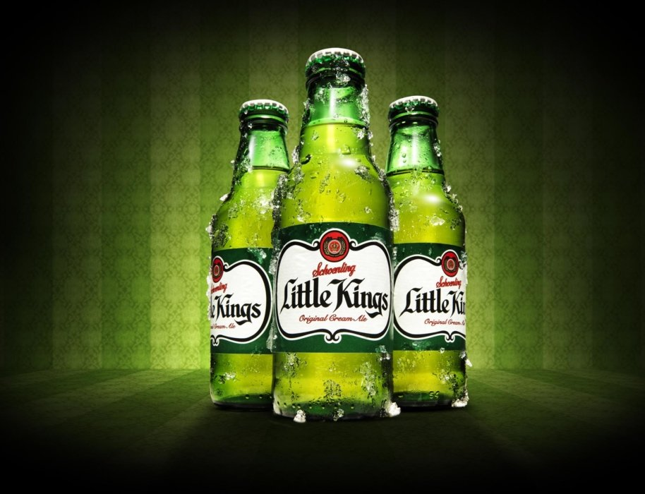 Three little kings cream ales in green bottles on a green background