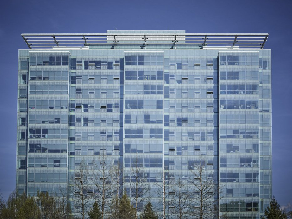 Exterior architectural shot of a large modern apartment building