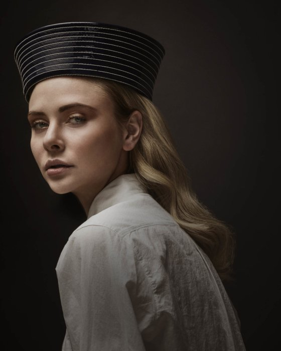Fashion shoot of a blonde woman with a stylish hat