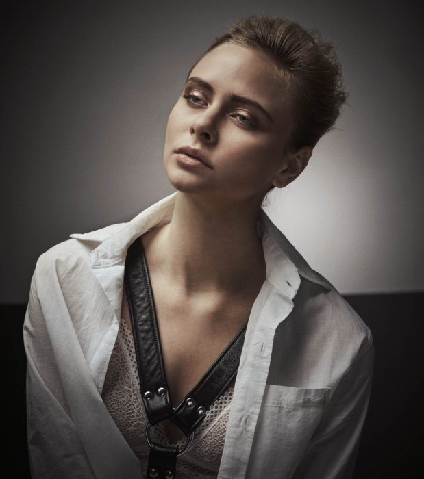Fashion shoot o f a blonde woman wearing a white shirt