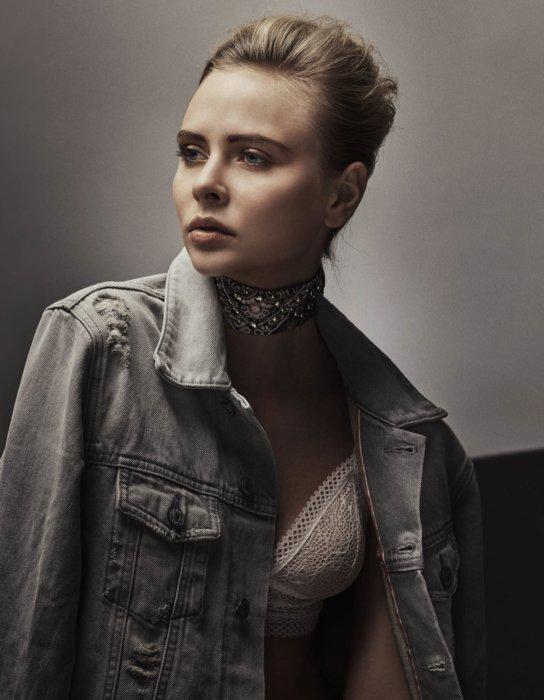 Fashion shoot o f a blonde woman wearing a jean jacket