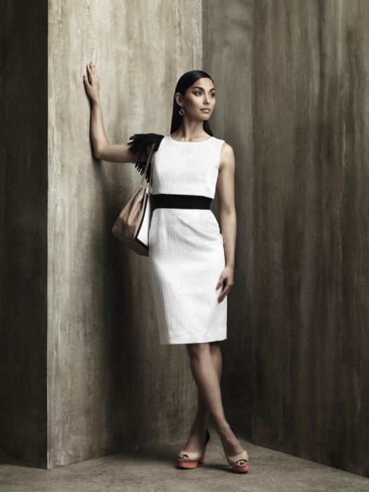 Female fashion model wearing white and black