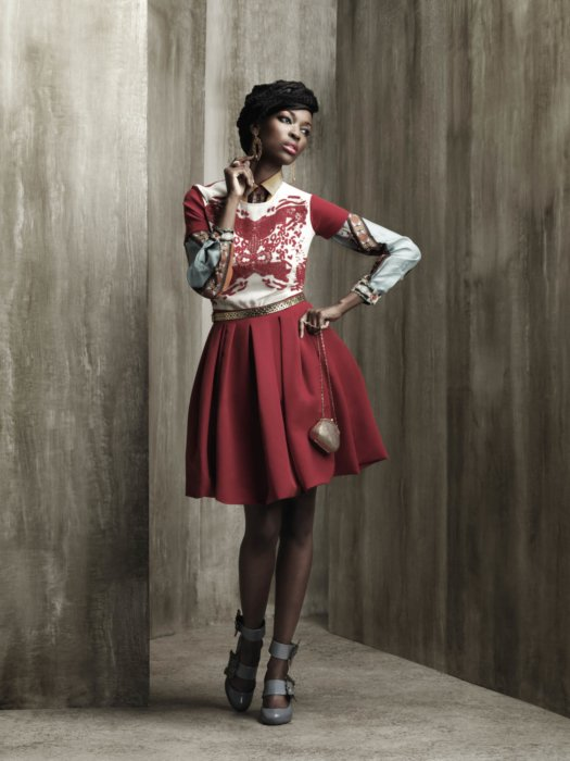 Female fashion model wearing a red dress
