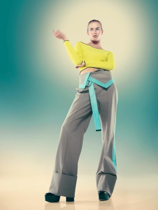 A female fashion model in yellow on a blue background