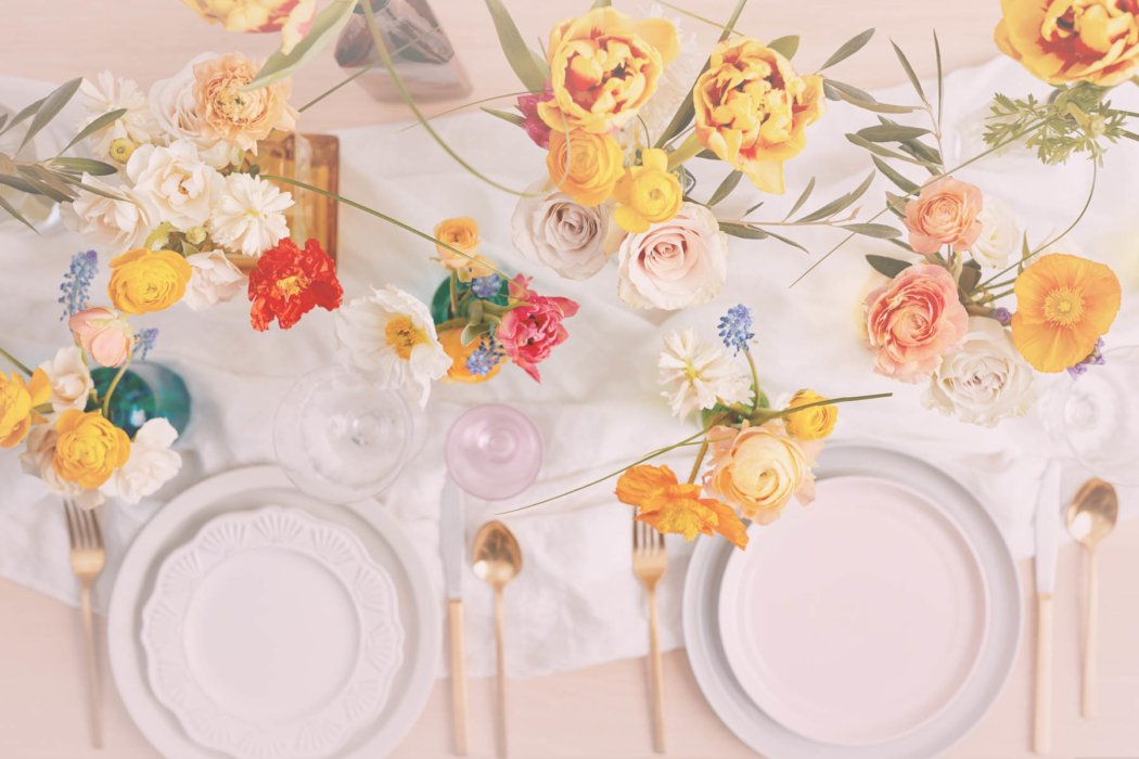 A top down display of flowers and plates