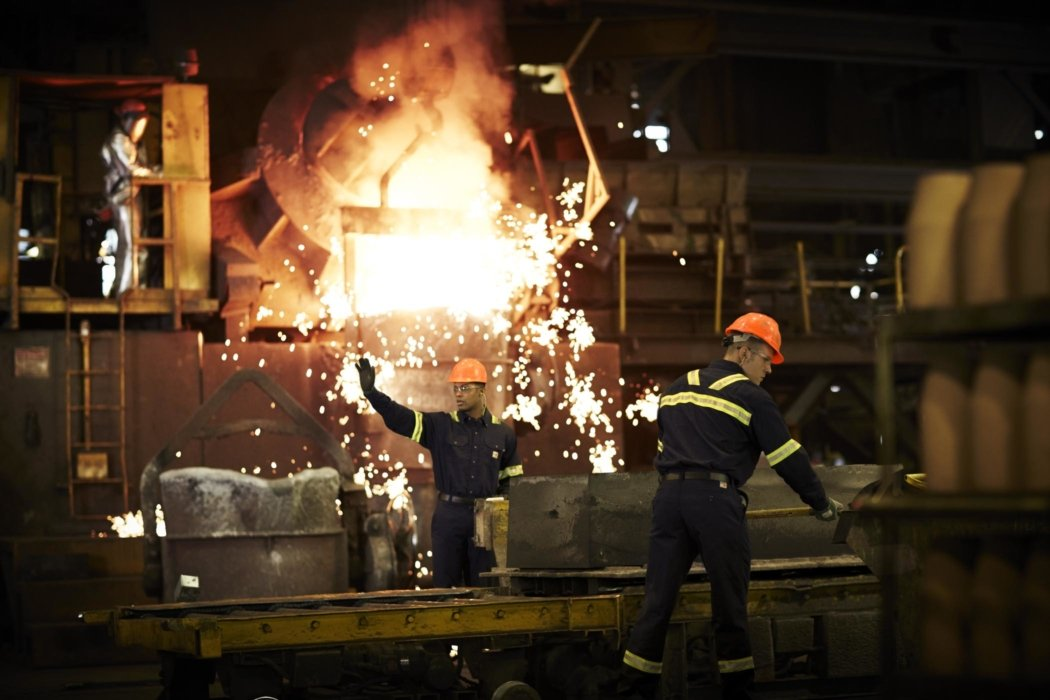 Industrial workers working in foundry
