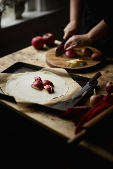 Person slicing apples for a turnover