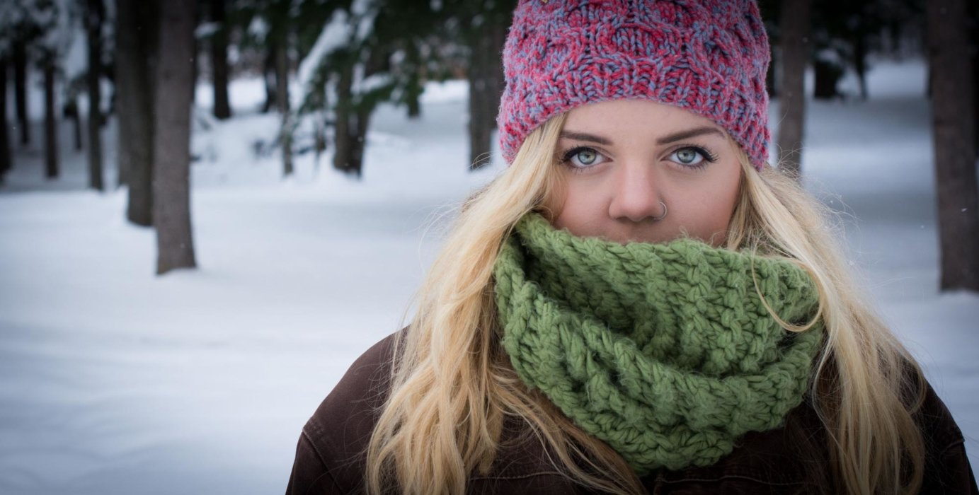 Girl in winter wearing green scarf
