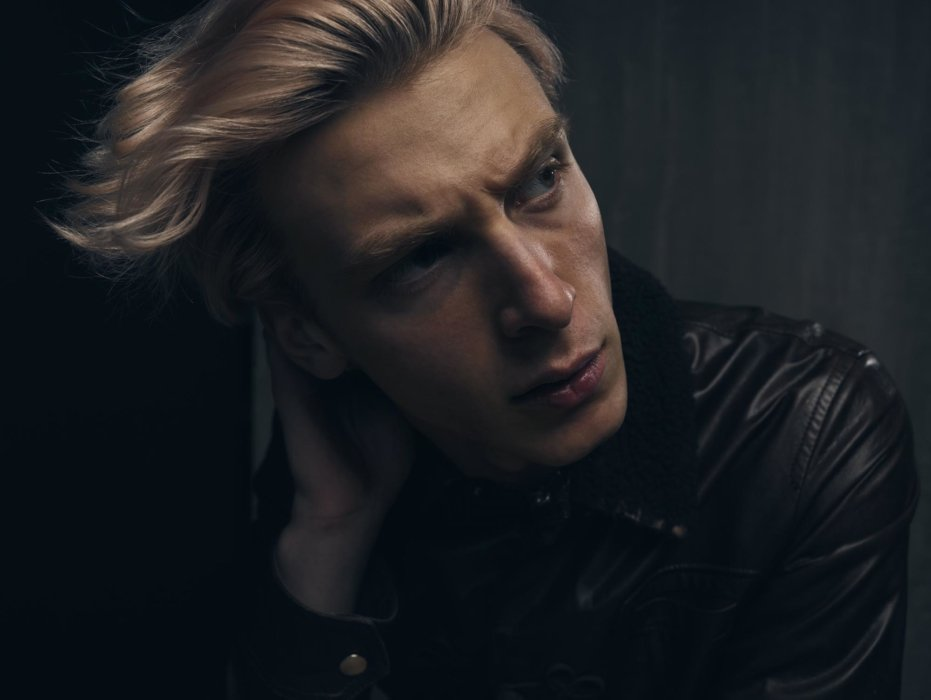 Portrait of a man with blonde hair and leather jacket