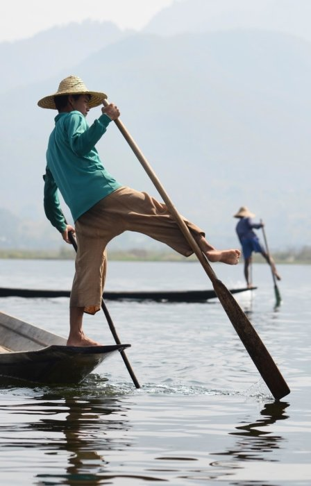 Travel photo of two men rowing boats