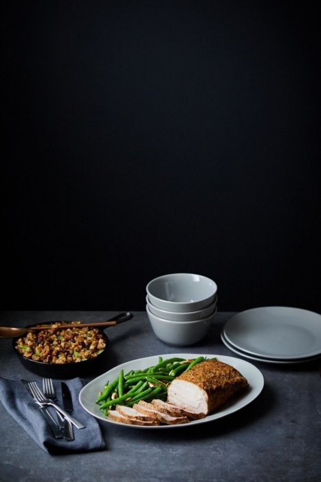 Pork dinner with green beans on a black background