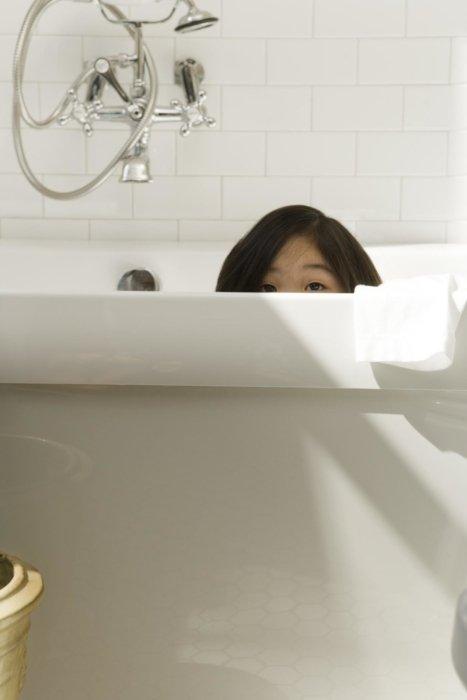 Lifestyle shot of a girl in a bathtub