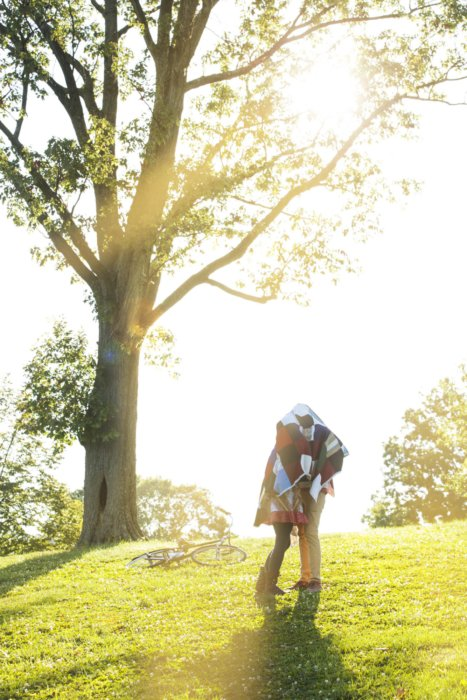 Lifestyle shot of a couple kissing outdoors