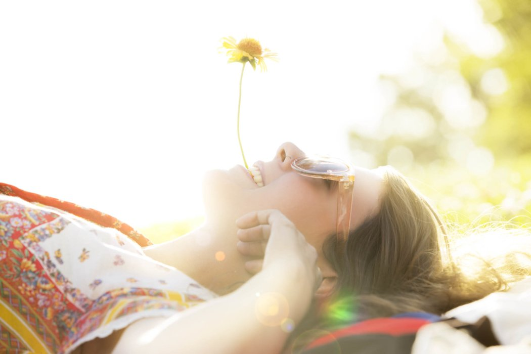 Lifestyle shot of a women with a flower