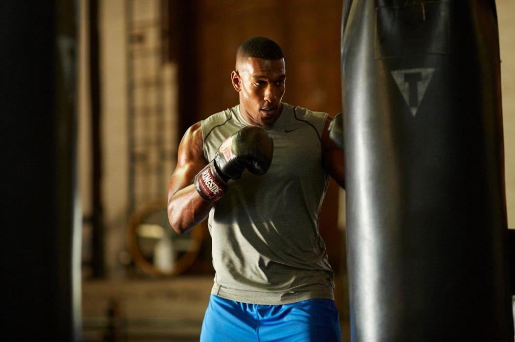 Male boxing athlete hitting a punching bag