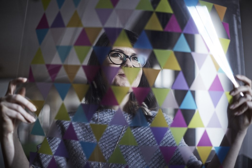 A woman looking at a transparent design