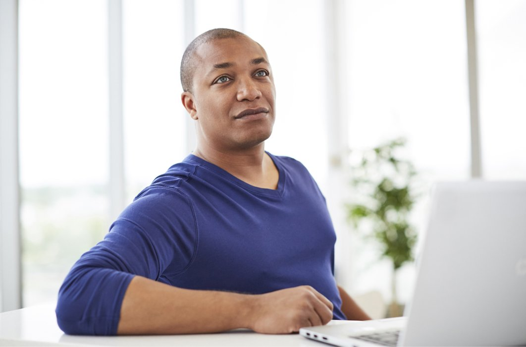 A corporate man with a laptop