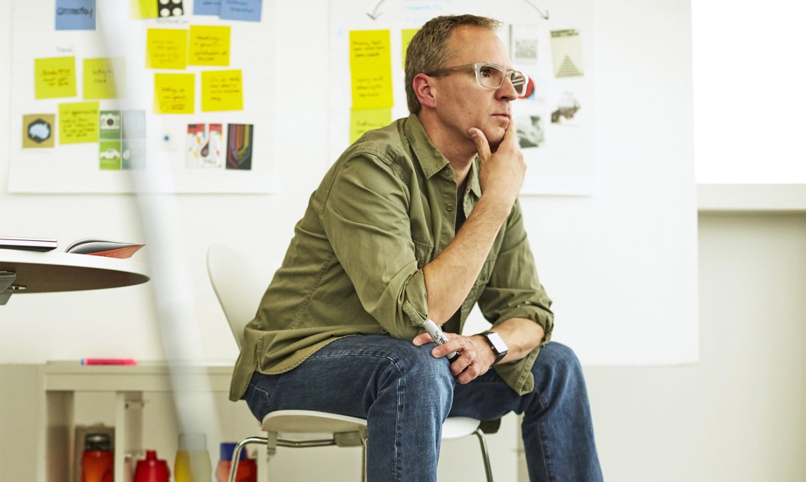 A man thinking in a brainstorm meeting