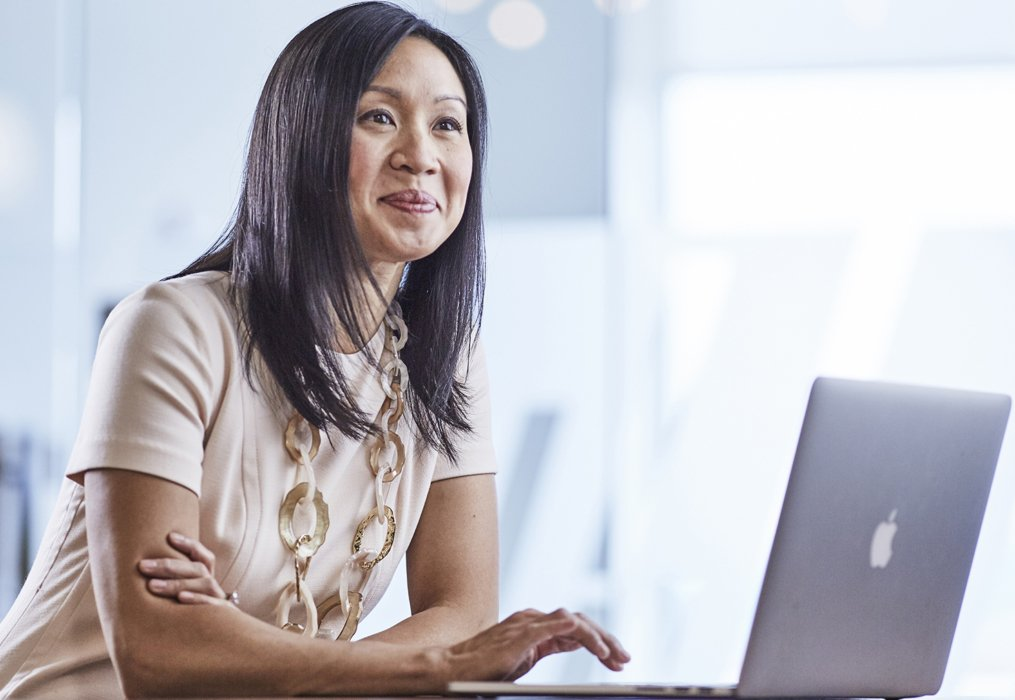 A corporate woman working on a laptop