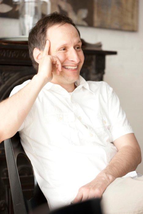 Monty Milburn Lifestyle photo of man at breakfast laughing