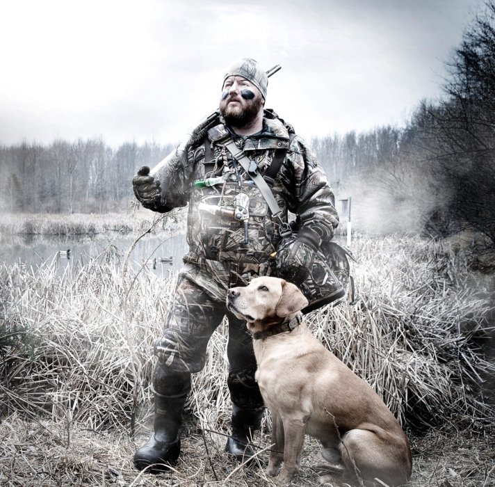 Man in hunting gear with his dog