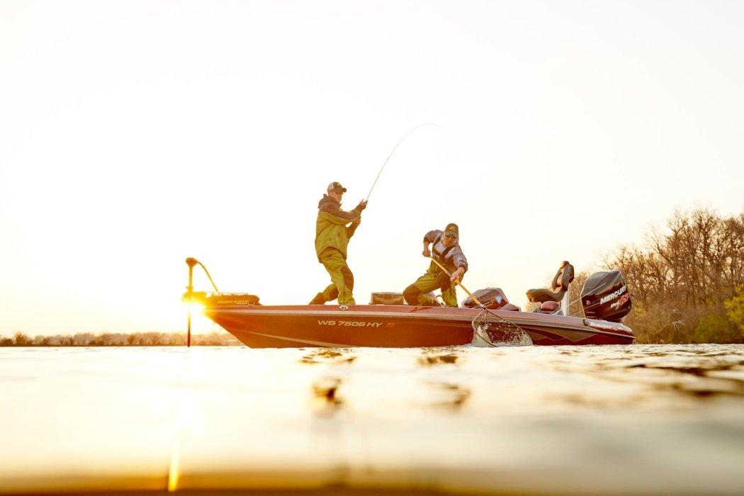 Sunset setting on fishermen on a boat