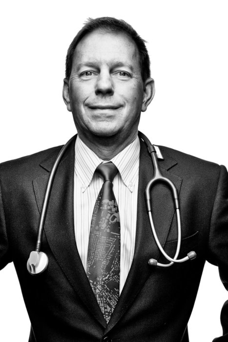 Portrait of a doctor in a suit and tie   Healthcare Photographer