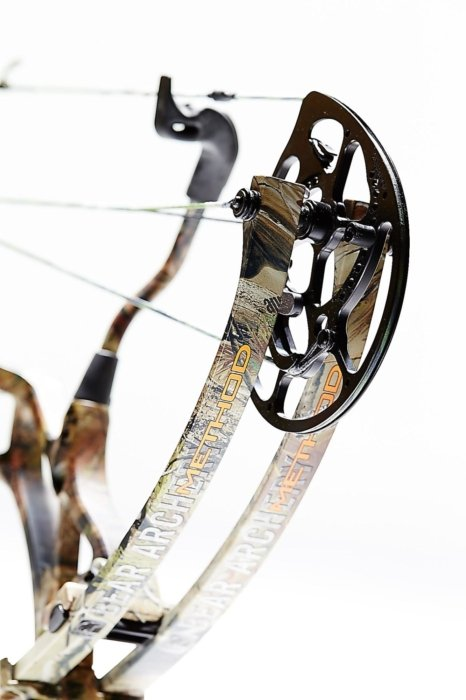 angled close up of a compound hunting bow pulley
