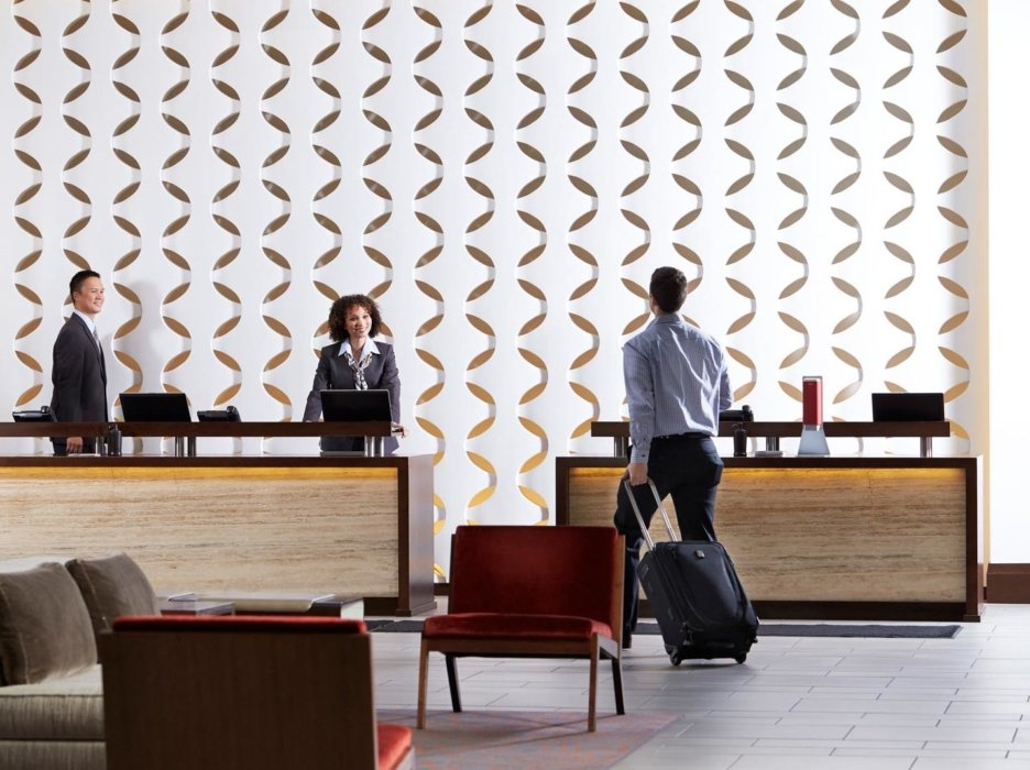 Workers in a hotel lobby