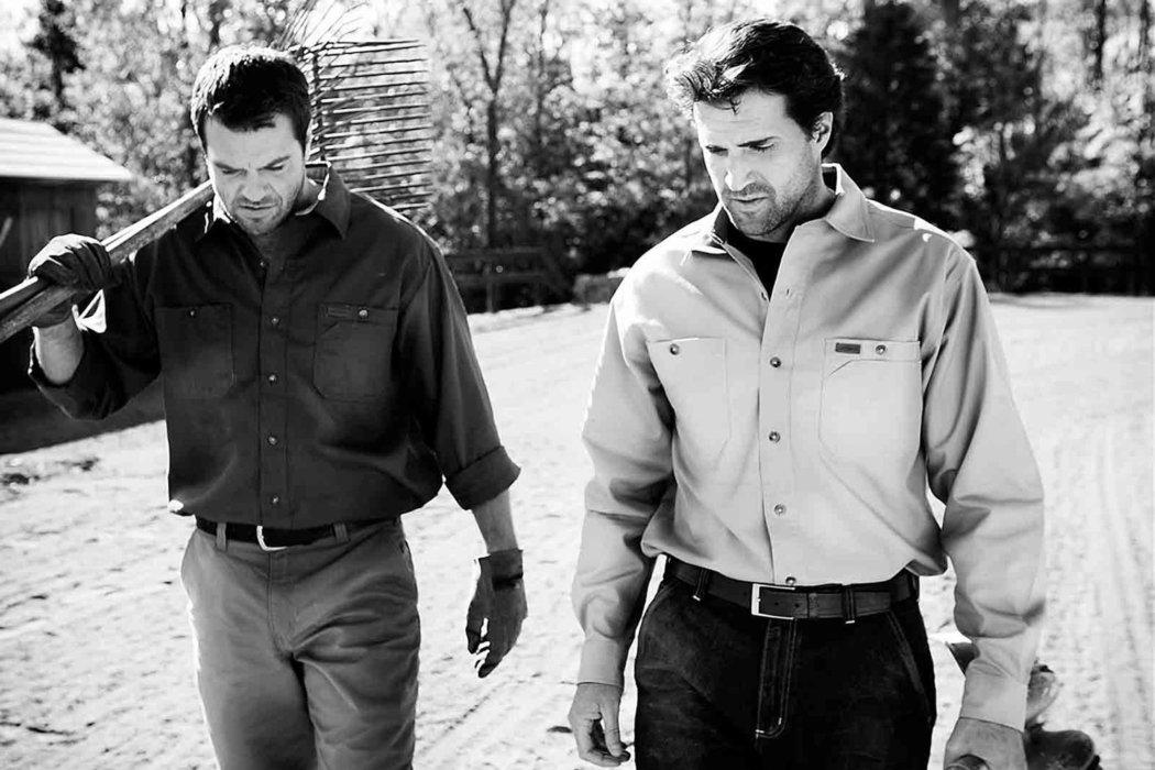 Two working men walking outside