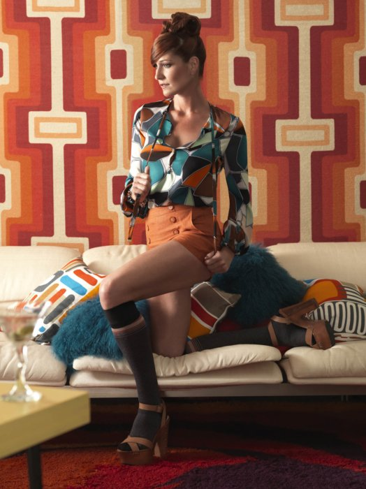 Fashion photography of a woman in 1970's attire and boots