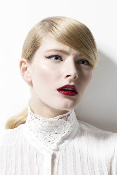 Fashion photo of a woman in white clothes and red lipstick
