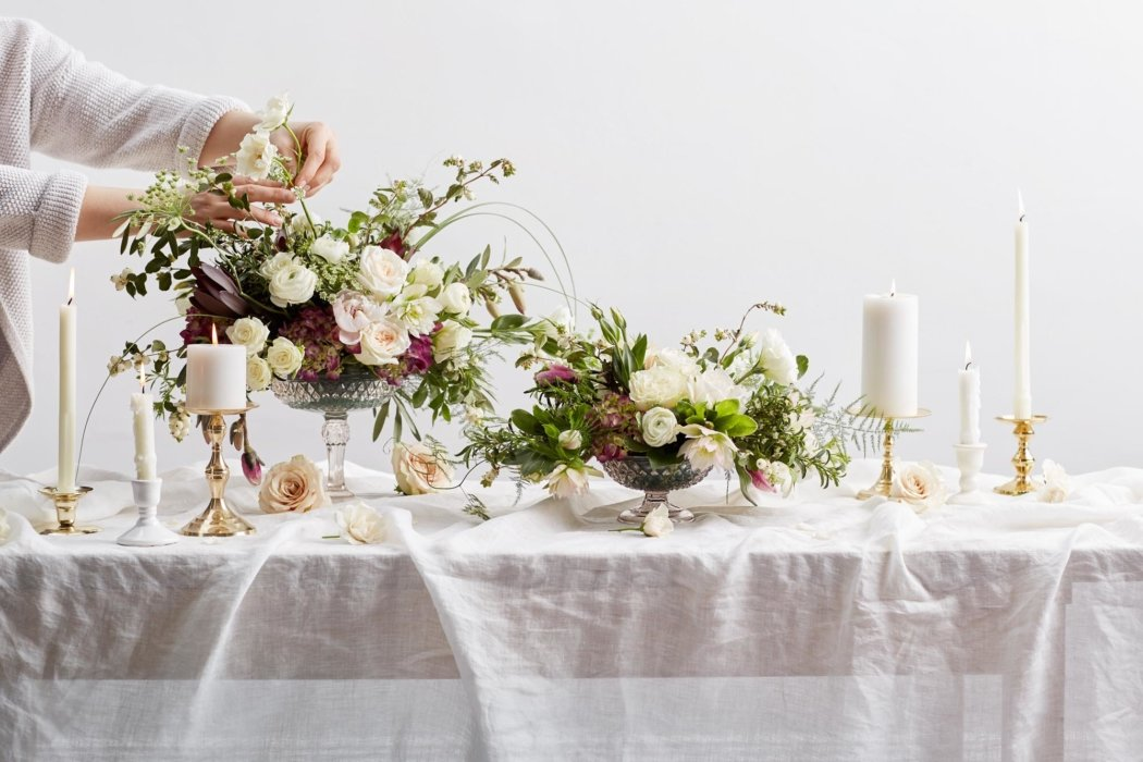 Flower arrangement on a table being prepared