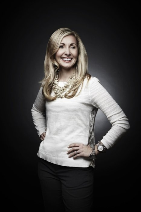 A corporate portrait of woman on a black background