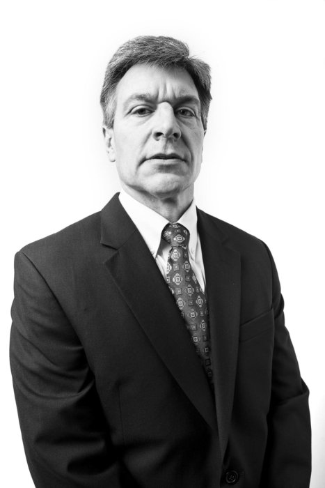 A corporate business man in a suit on a white background
