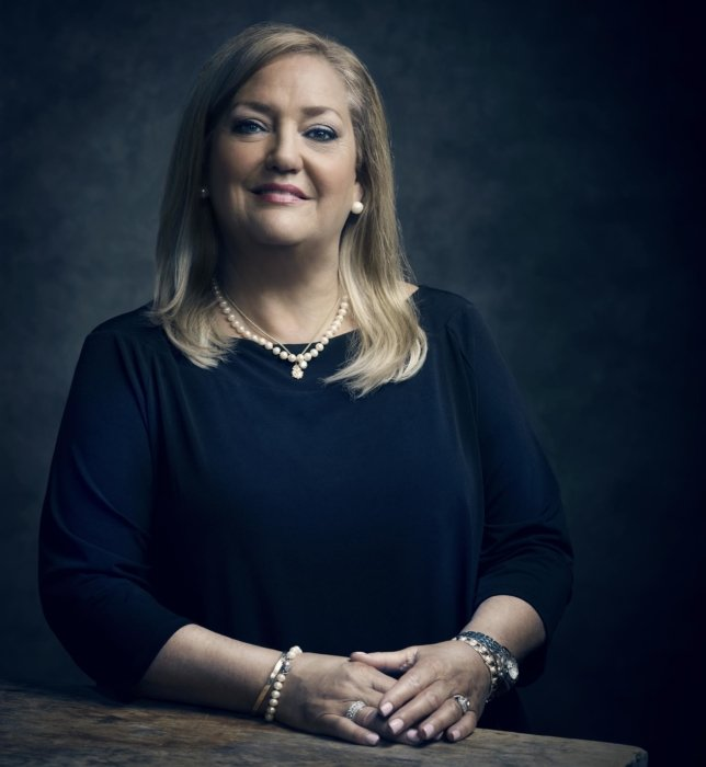 Portrait of a business woman on a dark background
