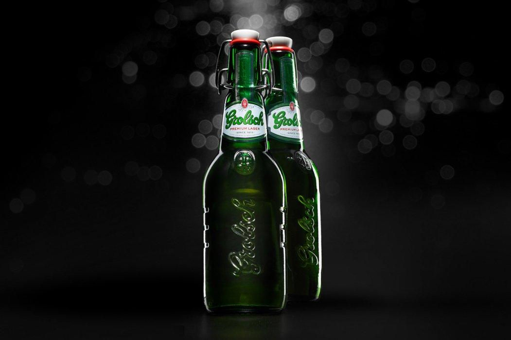 Grolsch green beer bottles on a black background