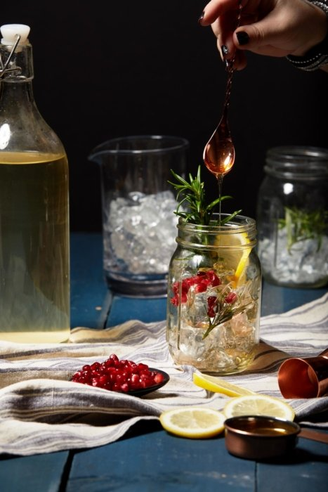 Cocktail preparation scene with lemons and ice
