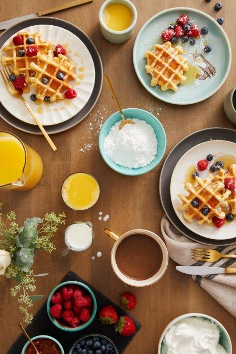 A breakfast spread with waffles