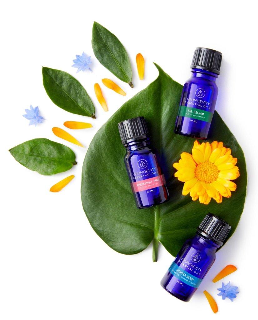 Essential oil bottles on leaves